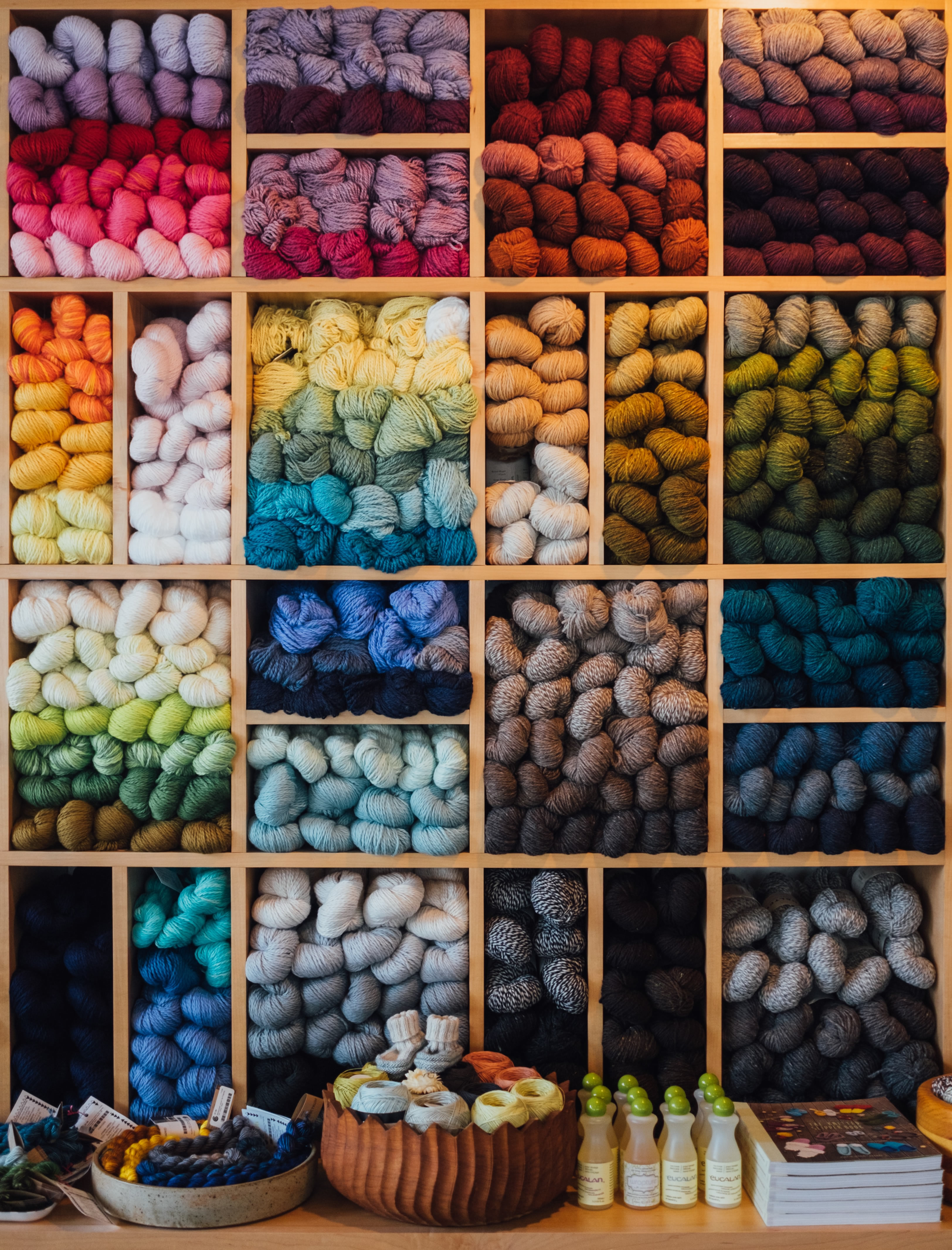 photo of cubbies filled with yarn